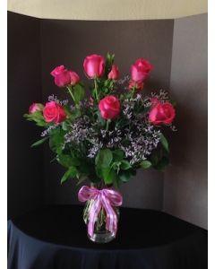 A dozen Red Roses with Purple Filler