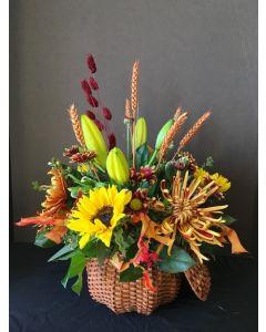 Thanksgiving Flowers in a Wicker Pumpkin